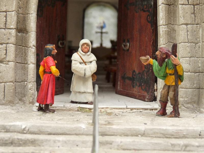 A la porte de l'église